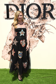 Kirsten Dunst looked absolutely charming in a star-beaded Swiss-dot dress by Dior during the label's Haute Couture show.
