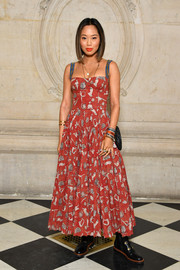 Aimee Song was summer-chic in a printed red corset dress by Dior during the brand's fashion show.