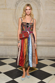 Chiara Ferragni finished off her vibrant ensemble with a studded red shoulder bag, also by Dior.