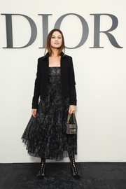 Olga Kurylenko attended the Christian Dior Spring 2019 show wearing a printed midi dress from the label.