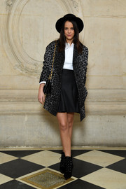 Pauline Ducruet teamed a gray leopard-print coat with a white shirt and a black mini skirt for the Dior Fall 2018 show.