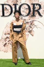 Winnie Harlow brought a safari vibe to the Dior Haute Couture show with this khaki pantsuit from the label.