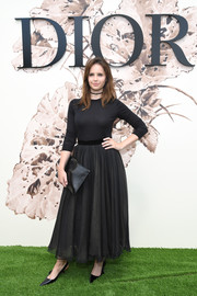 Felicity Jones kept it understated in a plain black sweater by Dior during the label's Haute Couture show.