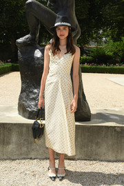 Margaret Qualley looked adorable in a pale yellow polka-dot dress by Dior during the brand's Couture Fall 2018 show.