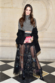 For a touch of color, Charlotte Le Bon accessorized with a pink leather clutch by Dior.