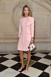 Arizona Muse channeled Jackie O with this demure pink coat at the Christian Dior fashion show.
