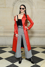 Charlotte Le Bon attended the Dior Fall 2018 show looking bold in a red leather trench from the brand.