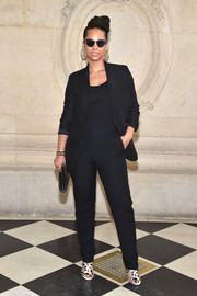 Alicia Keys styled her black look with a pair of strappy monochrome heels.