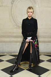 Lottie Moss kept it simple up top in a black silk button-down at the Dior Fall 2018 show.
