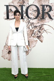 Gemma Arterton suited up in this white Dior jacket and pants ensemble for the label's Haute Couture show.
