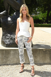 Annabelle Wallis teamed her top with a pair of print pants, also by Dior.