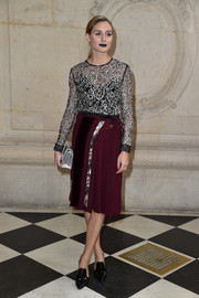 Olivia Palermo paired her top with a pleated wraparound skirt, in plum and silver.