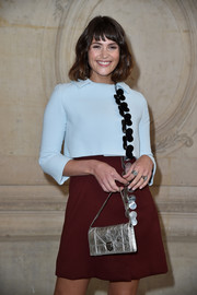 Gemma Arterton accessorized with a silver chain-strap purse by Dior when she attended the label's Spring 2017 show.