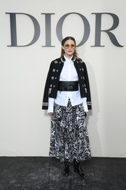 Olivia Palermo topped off her ensemble with a military-inspired jacket by Dior.