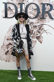 For her footwear, Jennifer Lawrence went athletic with a pair of boxing shoes, also by Dior.