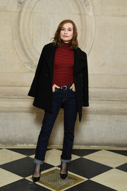 Isabelle Huppert was classic in blue jeans and a striped turtleneck at the Dior Fall 2018 show.