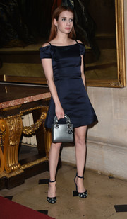 Emma Roberts tied her look together with a metallic blue Lady Dior purse.