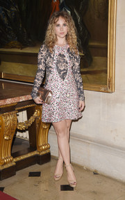 Juno Temple looked very fashion-forward in a Dior Couture beaded peekaboo mini dress layered over a lacy top during the label's Cruise show.