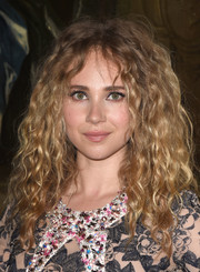 Juno Temple stuck to her signature voluminous curls when she attended the Christian Dior Cruise show.