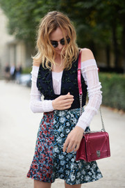 Diane Kruger headed to the Dior fashion show carrying a metallic-pink shoulder bag from the brand.