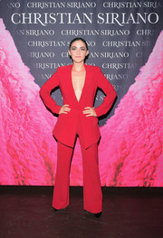 Isabelle Fuhrman was sizzling-hot in a plunging red suit at the 'Dresses to Dream About' book launch.