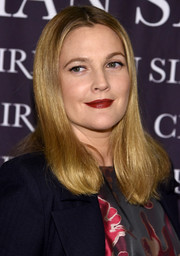 Drew Barrymore wore her hair down to her shoulders in a straight center-parted style at the 'Dresses to Dream About' book release.