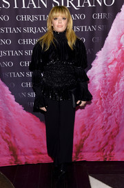 Natasha Lyonne bundled up in a black Christian Siriano turtleneck with tiered sleeves and a smocked midsection for the 'Dresses to Dream About' book release.