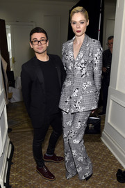 Coco Rocha suited up in a floral-embroidered jacket and pants combo for the Christian Siriano fashion show.