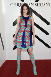 Coco Rocha amped up the vibrance with a pair of knee-high turquoise gladiator heels, also by Christian Siriano.