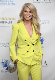 Christie Brinkley's Marzook crystal orb bag added major sparkle to her suit at Bella New York's Influencer issue launch party.
