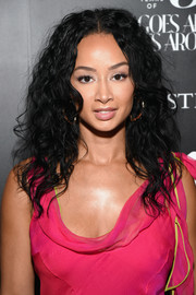 Draya Michele rocked a teased curly 'do at the Christie's x What Goes Around Comes Around 25th anniversary auction preview.