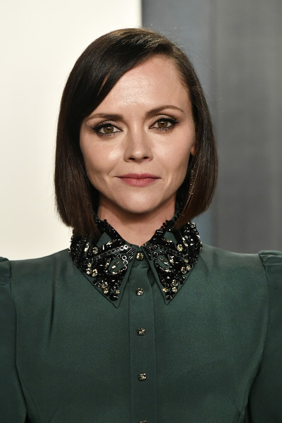 Christina Ricci Bob [hair,face,hairstyle,lip,beauty,collar,neck,fashion accessory,necklace,black hair,radhika jones - arrivals,radhika jones,christina ricci,california,beverly hills,wallis annenberg center for the performing arts,oscar party,vanity fair,christina ricci,oscar party,vanity fair,fashion,party,the addams family,academy awards,photograph,radhika jones,that darn cat]