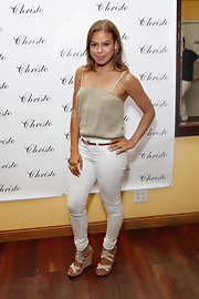 Toni Trucks wore a simple nude-colored, flowing blouse while at the Christo Men Press preview.