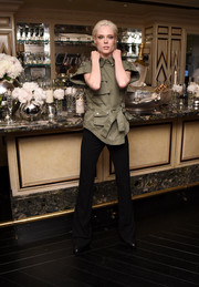 Coco Rocha paired her jacket with black bell-bottoms.