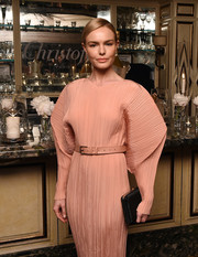 Kate Bosworth paired a micro-beaded black clutch by Judith Leiber with a futuristic dress for the launch of Idole de Christofle.