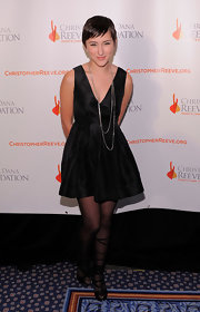 Zelda Williams wore wrap around strappy sandals. The black heels were worn over sheer black tights.
