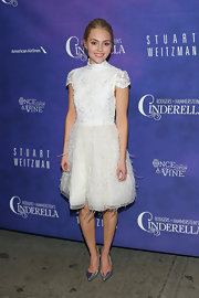 AnnaSophia Robb looked fun and flirty in a white feather dress with lace.