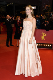Lily James looked absolutely darling in a blush-colored Dior strapless gown during the BIFF premiere of 'Cinderella.'
