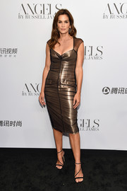 Cindy Crawford gleamed in a gold lurex and tulle dress byTom Ford at the 'Angels' by Russell James book launch.