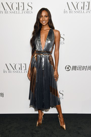 Jasmine Tookes coordinated her dress with mirrored gold pumps.