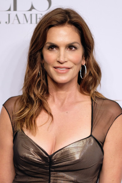 Cindy Crawford Long Wavy Cut [hair,hairstyle,brown hair,eyebrow,long hair,beauty,chin,blond,shoulder,layered hair,arrivals,cindy crawford,candice swanepoel host angels,russell james,angels,new york city,stephan weiss studio,russell james book launch and exhibit,exhibit,book launch]