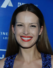 Petra Nemcova wore a vibrant orange-red lipstick at the Cinema for Peace Benefit.