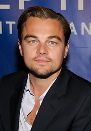 Leonardo DiCaprio attended the Cinema for Peace event wearing his signature slicked-back hairstyle.