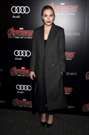 Elizabeth Olsen looked a lot like her sisters in this oversized gray coat by The Row when she attended the 'Avengers: Age of Ultron' screening.