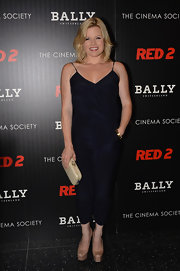 Megan sported a cool and contemporary look at the NYC screening of 'Red 2,' where she wore this fitted, navy jumpsuit.