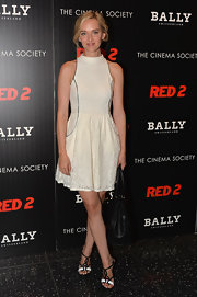 Jess Weixler chose a white lace frock with structured black piping for her look at the screening of 'Red 2.'