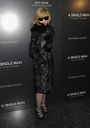 Madonna looked mysterious at 'A Single Man' premiere in a crushed velvet evening coat with a feather collar.