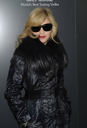 Madonna was dark and mysterious in a long coat and black sunglasses.