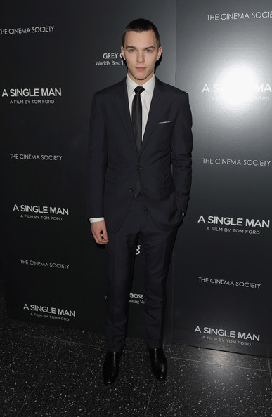 Nicholas looked handsome in a slick navy suit and skinny tie.