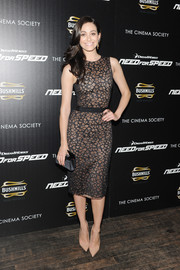 Emmy Rossum paired her dress with a black satin clutch by Christian Louboutin.